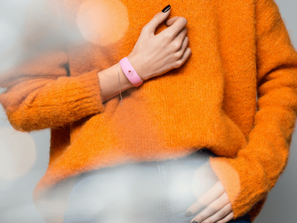Girl wears cozy AMBRIO bracelet
