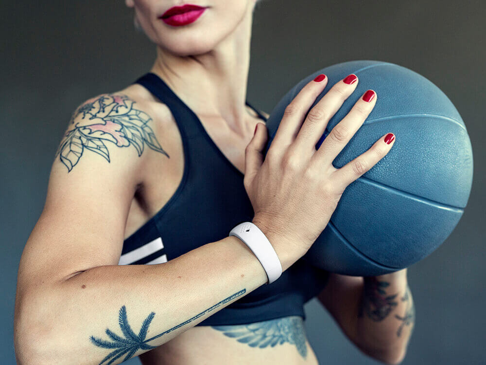 The lady is exercising when wearing her sporty AMBRIO bracelet